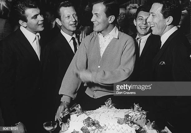 Fabian Forte Donald O'Connor Frankie Avalon Andy Williams and Pat Boone cutting his birthday cake during party at the Ambassador Hotel