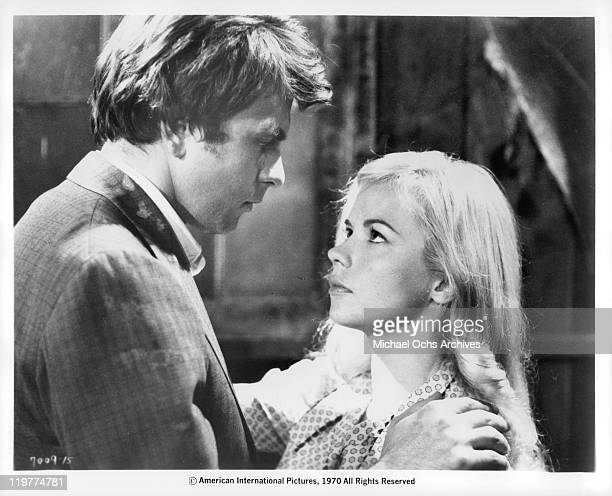 Fabian Forte holding wife Astrid Warner in a scene from the film 'A Bullet For Pretty Boy' 1970