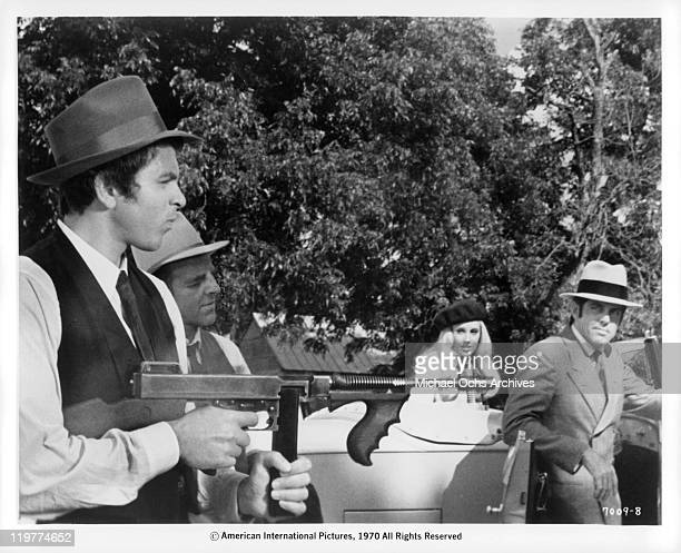 Fabian Forte is introduced to seasoned bank robber Michael Haynes who teaches him how to operate a machine gun in a scene from the film 'A Bullet For...
