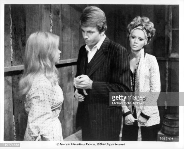 Fabian Forte tries to convince Astrid Warner that he still loves her while Jocelyn Lane watches on in a scene from the film 'A Bullet For Pretty Boy'...