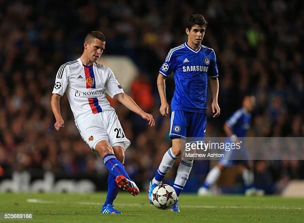 Fabian Frei of FC Basel and Oscar of Chelsea