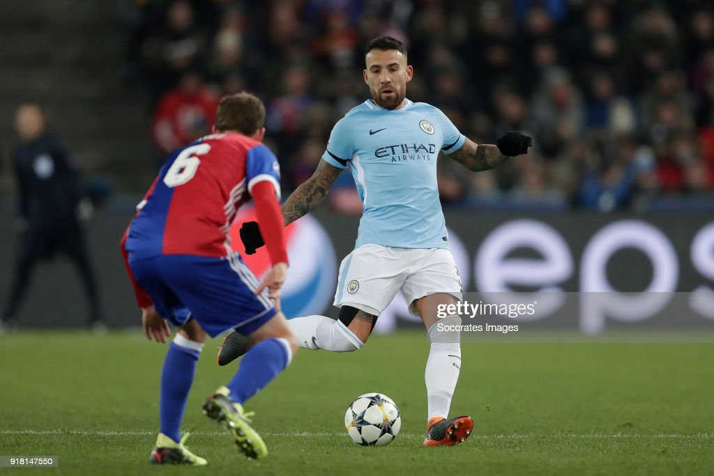 https://media.gettyimages.com/photos/fabian-frei-of-fc-basel-nicolas-otamendi-of-manchester-city-during-picture-id918147550