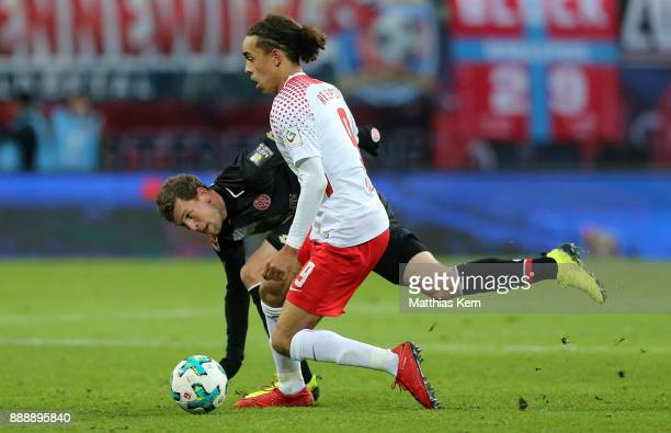 Fabian Frei of Mainz battles for the ball with Yussuf Poulsen of Leipzig during the Bundesliga match between RB Leipzig and 1FSV Mainz 05 at Red Bull...