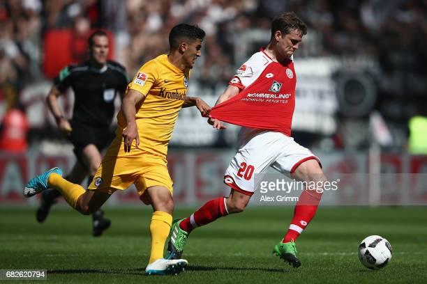 Fabian Frei of Mainz is challenged by Aymane Barkok of Frankfurt during the Bundesliga match between 1 FSV Mainz 05 and Eintracht Frankfurt at Opel...