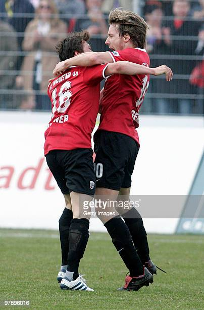 Fabian Gerber of FC Ingolstadt celebrates after scoring his team's first goal with team mate Andreas Buchner during the 3Liga match between FC...