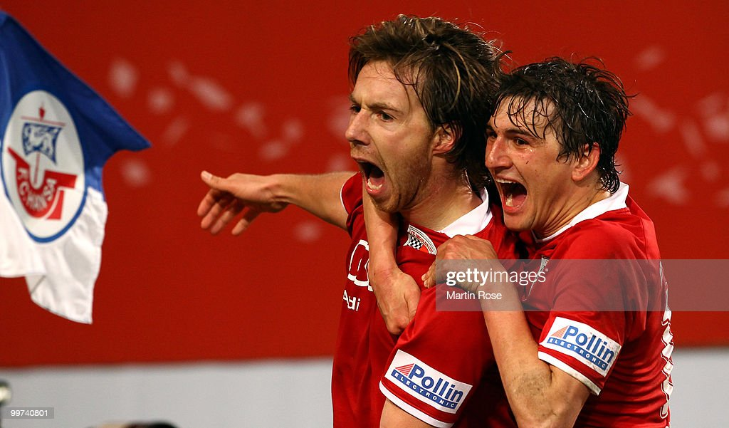 Fabian Gerber (L) of Ingolstadt celebrates with team mate Andreas Buchner after he scores his team's 2nd goal during the Second Bundesliga play off leg two match between Hansa Rostock and FC Ingolstadt 04 at DKB Arena on May 17, 2010 in Rostock, Germany.