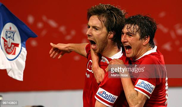 Fabian Gerber of Ingolstadt celebrates with team mate Andreas Buchner after he scores his team's 2nd goal during the Second Bundesliga play off leg...