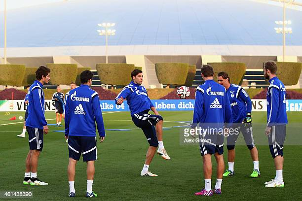 Fabian Giefer and team mates juggle with the ball during day 7 of the FC Schalke 04 training camp at the ASPIRE Academy for Sports Excellence on...