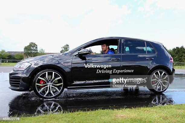 Fabian Giefer of Schalke drives a Volkswagen car during a test drive at driving safety centre Rheinberg on August 12 2014 in Rheinberg Germany