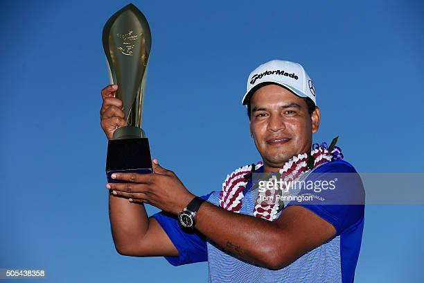 Fabian Gomez of Argentina celebrates with the winner's trophy after defeating Brandt Snedeker during a playoff during the final round of the Sony...