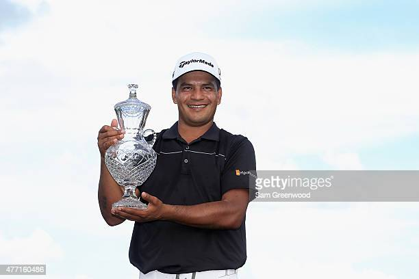 Fabian Gomez of Argentina poses with the winner's trophy after winning the final round of the FedEx St. Jude Classic at TPC Southwind on June 14,...