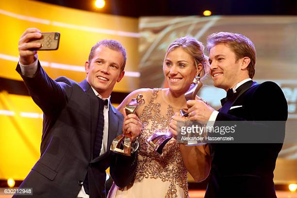 Fabian Hambuechen Angelique Kerber and Nico Rosberg pose with their Sportler des Jahres 2016 awards during the Sportler des Jahres 2016 gala at...