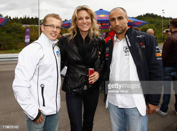 Fabian Hambuechen, Christina Surer and Arthur Abraham attend the Red Bull On Track event at the Driving Safety Center on July 23, 2011 in Nuerburg,...