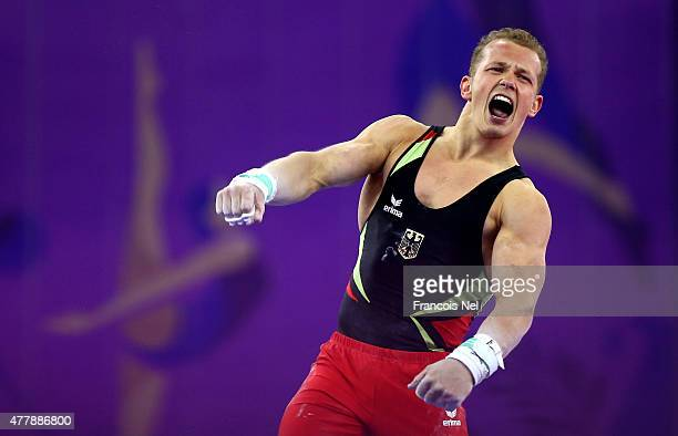 Fabian Hambuechen of Germany celebrates during the Men's Horizontal Bar final on day eight of the Baku 2015 European Games at the National Gymnastics...