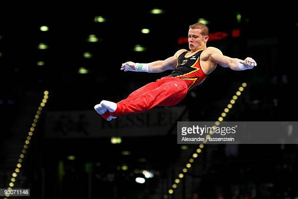 Fabian Hambuechen of Germany competes at the high bar during the Champions Trophy 2009 at the Porsche Arena on November 15, 2009 in Stuttgart,...