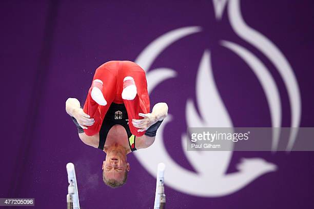 Fabian Hambuechen of Germany competes on the parallel bars during the Men's Artistic Gymnastics Team and All Around qualification on day three of the...
