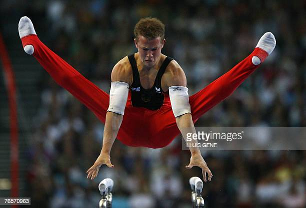 Fabian Hambuechen of Germany competes on the parallel bars during the men's individual allaround final of the 40th World Artistic Gymnastics...