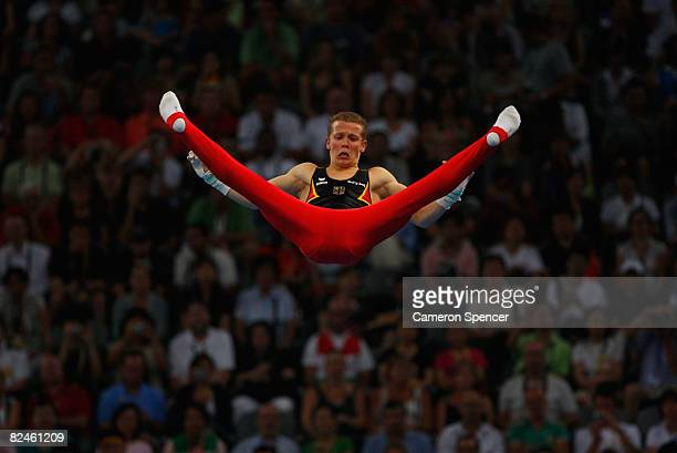 Fabian Hambuechen of Germany competes on the parallel bars in the artistic gymnastics event at the National Indoor Stadium on Day 11 of the Beijing...