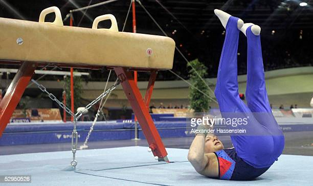 Fabian Hambuechen of Germany falls as he performs on the Pommel Horse during the International German Gymnastics Festival on May 19 2005 in Berlin...