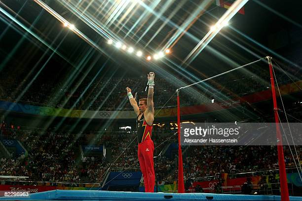 Fabian Hambuechen of Germany finishes his high bar routine in the men's individual all-around final in the artistic gymnastics event at the National...