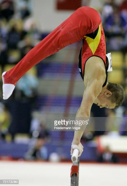 Fabian Hambuechen of Germany performs on the parallel bars in the mens qualification at the World Artistic Gymnastics Championships on October 15...