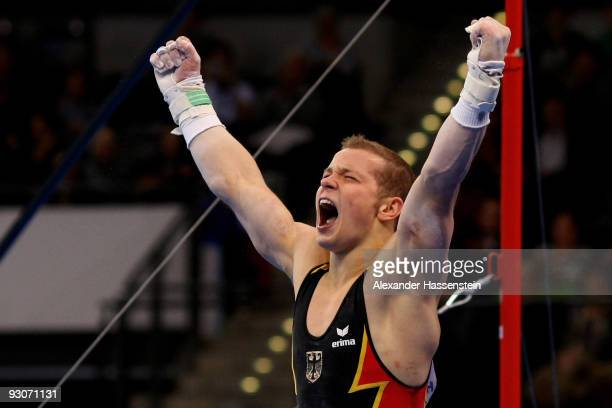 Fabian Hambuechen of Germany reacts after competing at the high bar during the Champions Trophy 2009 at the Porsche Arena on November 15, 2009 in...