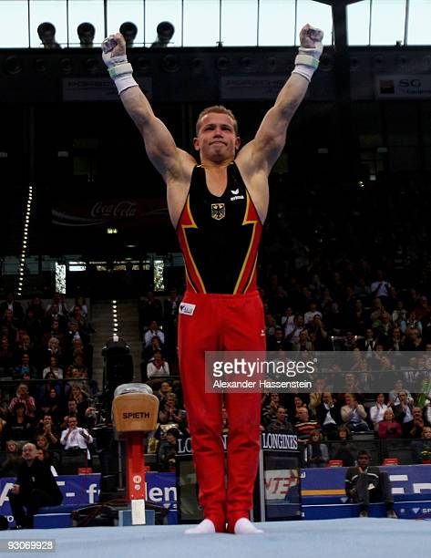 Fabian Hambuechen of Germany reacts after competing at the rings during the Champions Trophy 2009 at the Porsche Arena on November 15, 2009 in...