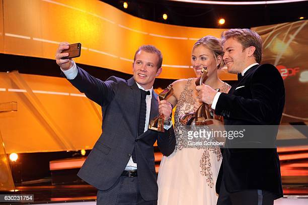 Fabian Hambuechen Olympic gold medalist champion takes a selfie with Tennis Champion Angelique Kerber and Nico Rosberg Formula One F1 driver and...