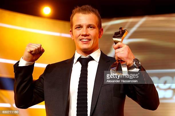 Fabian Hambuechen poses with his Sportler des Jahres 2016 award during the Sportler des Jahres 2016 gala at Kurhaus Baden-Baden on December 18, 2016...