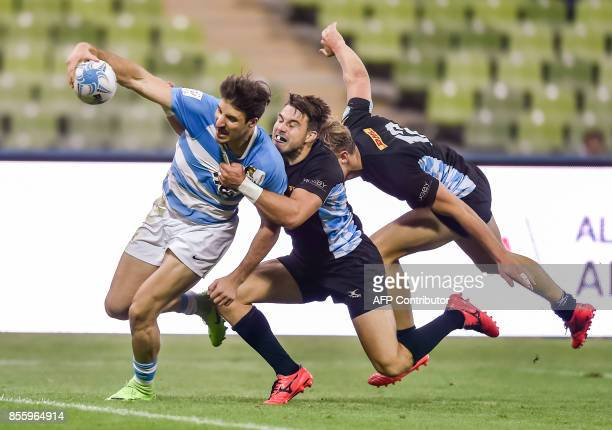 Fabian Heimpel and Tim Lichtenberg of Germany tackle Felipe de Mestre of Argentina during the match for place 5 Argentina vs Germany at the Rugby...