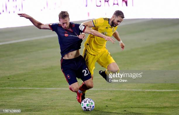 Fabian Herbers of Chicago Fire and Josh Williams of Columbus Crew compete for the ball in the second half during their game at MAPFRE Stadium on...