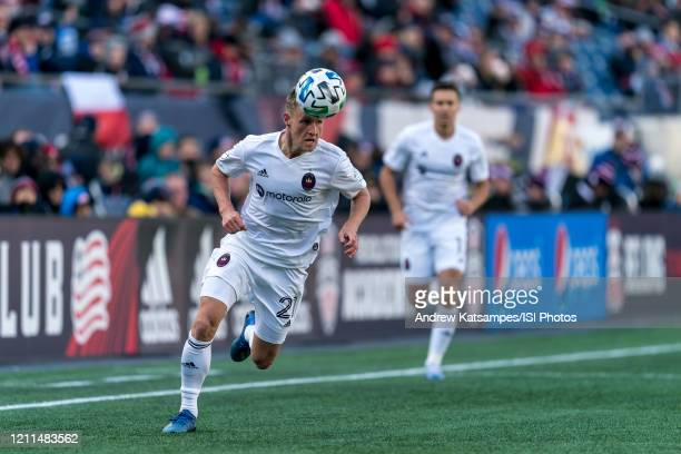 Fabian Herbers of Chicago Fire controls the ball with his head as he brings ball down the wing during a game between Chicago Fire and New England...