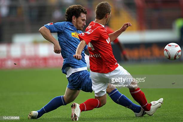 Fabian Hergessell of Oberhausen and Paul Freier of Bochum battle for the ball during the Second Bundesliga match between RW Oberhausen and VfL Bochum...