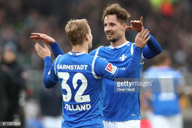 Fabian Holland and Sandro Sirigu of Darmstadt celebrate after the Second Bundesliga match between FC St Pauli and SV Darmstadt 98 at Millerntor...