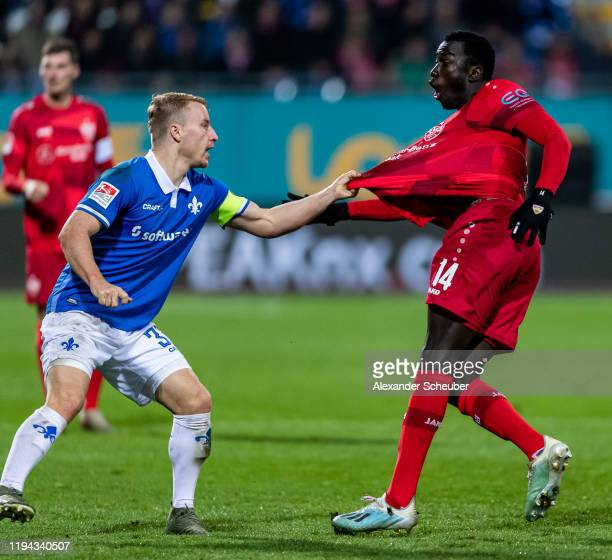 Fabian Holland of Darmstadt in action against Silas Wamangituka of Stuttgart during the Second Bundesliga match between SV Darmstadt 98 and VfB...
