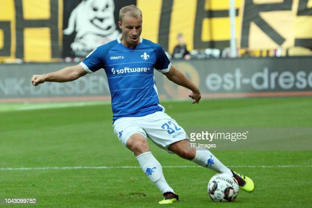 Fabian Holland of SV Darmstadt controls the ball during the Second Bundesliga match between SG Dynamo Dresden and SV Darmstadt 98 at DDVStadion on...