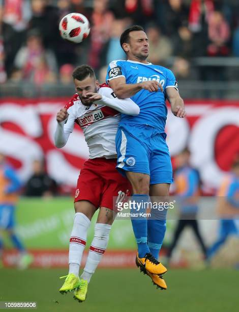 Fabian Holthaus of Cottbus jumps for the ball with Alexander Langlitz of Lotte during the 3. Liga match between FC Energie Cottbus and VfL...
