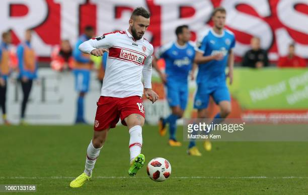 Fabian Holthaus of Cottbus runs with the ball during the 3 Liga match between FC Energie Cottbus and VfL Sportfreunde Lotte at Stadion der...