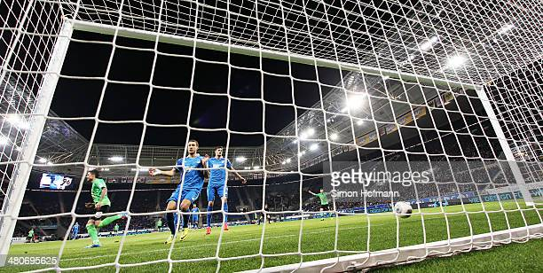 Fabian Johnson and Tobias Strobl of Hoffenheim react as Leon Andreasen of Hannover scores his team's first goal during the Bundesliga match between...