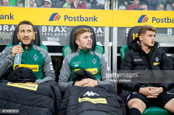 Fabian Johnson Christoph Kramer and Michael Cuisance of Borussia Moenchengladbach on the bench during the Bundesliga match between Borussia...