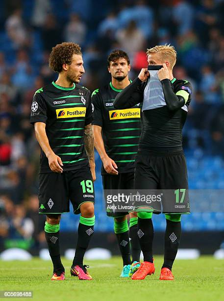 Fabian Johnson of and Oscar Wendt of Borussia Moenchengladbach show their dejection after the UEFA Champions League match between Manchester City FC...