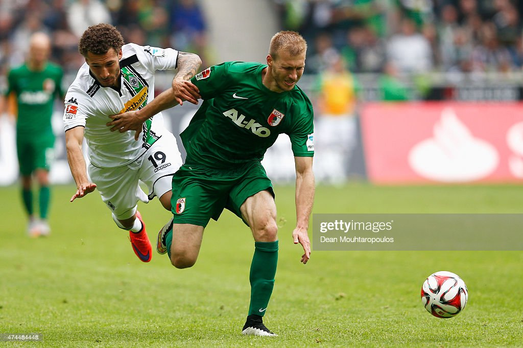 Fabian Johnson of Borussia Moenchengladbach and Ragnar Klavan of FC Augsburg battle for the ball during the Bundesliga match between Borussia Moenchengladbach and FC Augsburg held at Borussia Park Stadium on May 23, 2015 in Moenchengladbach, Germany.