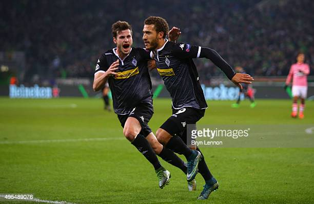 Fabian Johnson of Borussia Moenchengladbach celebrates with Havard Nordtveit as he scorer their frist goal during the UEFA Champions League Group D...