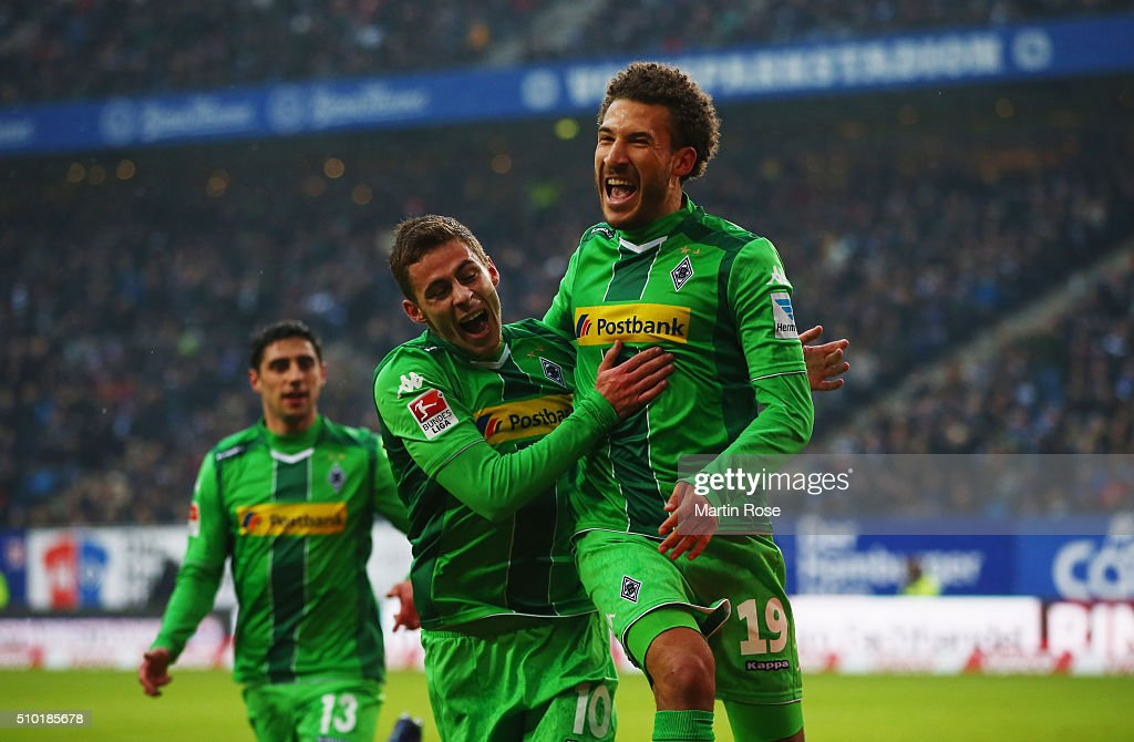 Fabian Johnson of Borussia Moenchengladbach (19) celebrates with Thorgan Hazard (10) as he scores their first goal during the Bundesliga match between Hamburger SV and Borussia Moenchengladbach at Volksparkstadion on February 14, 2016 in Hamburg, Germany.
