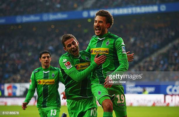 Fabian Johnson of Borussia Moenchengladbach celebrates with Thorgan Hazard as he scores their first goal during the Bundesliga match between...