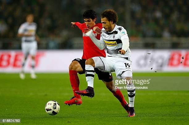 Fabian Johnson of Gladbach and Jesus Vallejo of Frankfurt battle for the ball during the Bundesliga match between Borussia Moenchengladbach and...