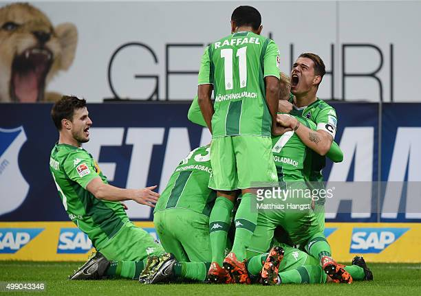 Fabian Johnson of Gladbach celebrates with his teammates after scoring his team's third goal during the Bundesliga match between 1899 Hoffenheim and...