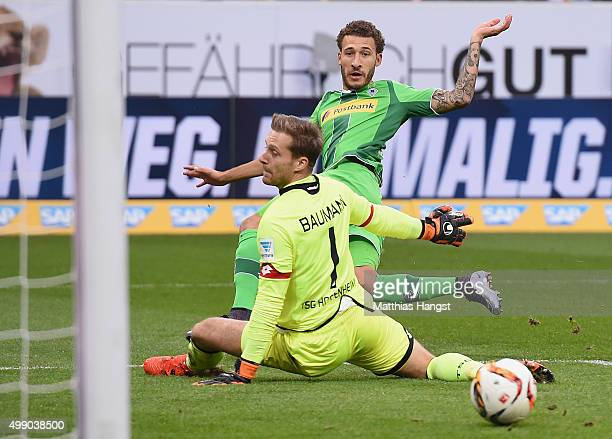 Fabian Johnson of Gladbach scores his team's first goal past goalkeeper Oliver Baumann of Hoffenheim during the Bundesliga match between 1899...