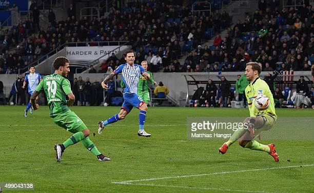 Fabian Johnson of Gladbach scores his team's third goal past goalkeeper Oliver Baumann of Hoffenheim during the Bundesliga match between 1899...