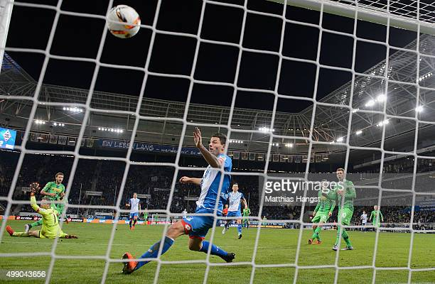 Fabian Johnson of Gladbach scores his team's third goal past goalkeeper Oliver Baumann of Hoffenheim and Fabian Schaer of Hoffenheim during the...